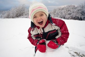 happy kid in the snow